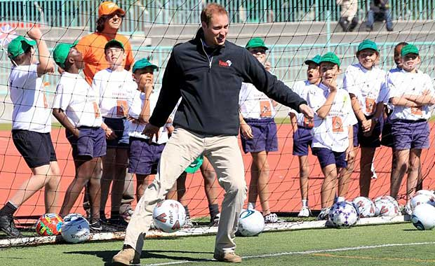 COACHING FOR CONSERVATION The Duke of Cambridge enjoys a game of football with schoolchildren attending a C4C camp