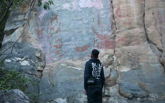 Luke looking at Rock art