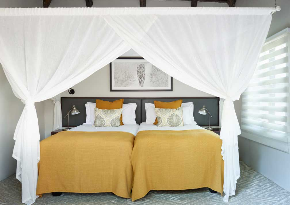 Sanctuary Chobe Chilwero luxury suite beds