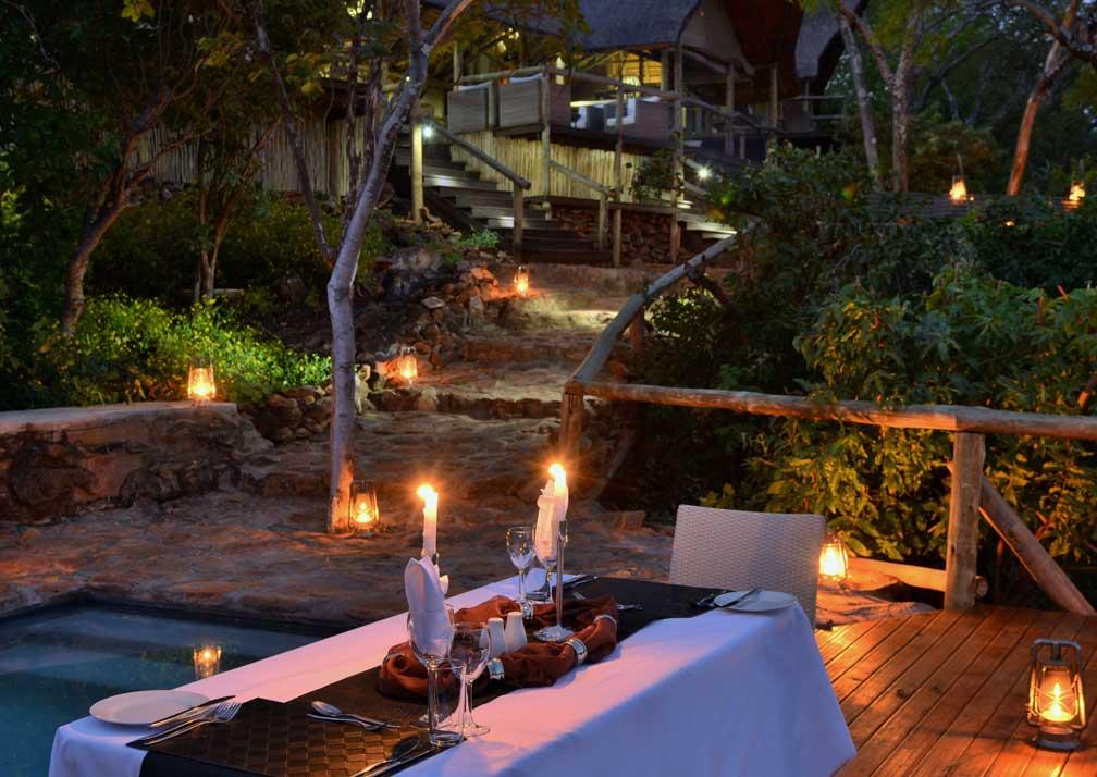 Ghoha Hills Savuti Lodge outdoor dining at night