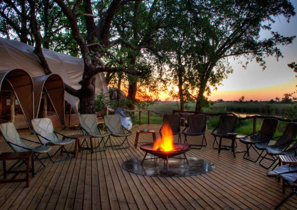 Camp Okuti fireside seating at sunset