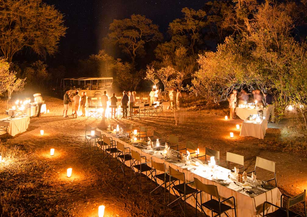 Little Machaba Camp outdoor dining at night