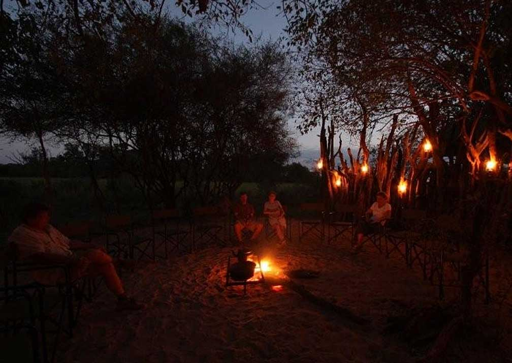 Sango Safari Camp fireside at sunset