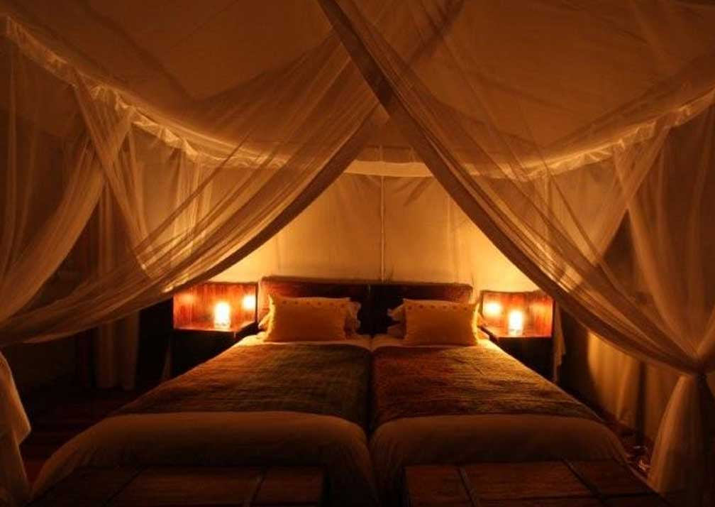 Sango Safari Camp bedroom at night